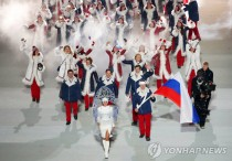 epa06369457 (FILE) - Team Russia with flag bearer Alexander Zubkov (C-R) during the Opening Ceremony of the Sochi 2014 Olympic Games at the Fisht Olympic Stadium in Sochi, Russia, 07 February 2014 (reissued 05 December 2017). The International Olympic Committee (IOC) on 05 December 2017 announced that the Russian Olympic Committee has been banned from the 2018 Winter Olympic Games in Pyeongchang, South Korea, following an investigation into allegations of state-sponsored doping at the Sochi 2014 Olympics. Some Russian athletes, who can prove they are not implicated in the doping scandal, will compete in Pyeongchang under a neutral flag.  EPA/BARBARA WALTON *** Local Caption *** 52752831/2017-12-06 03:57:13/
