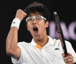 epaselect epa06464508 Hyeon Chung of of South Korea celebrates his win against Novak Djokovic of Serbia during round four on day eight of the Australian Open tennis tournament, in Melbourne, Victoria, Australia, 22 January 2018.  EPA/LUKAS COCH AUSTRALIA AND NEW ZEALAND OUT/2018-01-22 22:27:13/